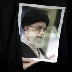 An Iranian hardline student holds a portrait of Iran's supreme leader, Ayatollah Ali Khamenei, during a gathering outside the former U.S. embassy in Tehran in 2011. Khamenei has been an opponent of the Baha'i minority in Iran. Photograph by: Behrouz Mehri , AFP/Getty Images