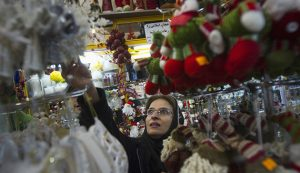 Iranian-Christian woman looks at Christmas decorations while shopping in central Tehran
