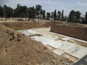 Plans to build a sports and cultural complex over a Baha'i cemetery have resumed with concrete being poured into the site where the graves of Baha'is were excavated in order to lay the building foundation. Demolition of the cemetery, which began in late April, had temporarily stopped after the international media reported on the desecration and other governments expressed concern.
