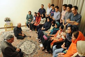 In a photograph posted earlier this month to several Persian-language websites, Muhammad Nourizad, a former journalist with the semi-official Kayhan newspaper, and Muhammad Maleki, the first head of Tehran University following the Islamic Revolution, are seen on their knees in humility before a group of Baha'i students.