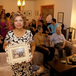 Jinous Nourinejad displays a photo of her family in Tehran along with her father before his disappearance in 1980. Photo submitted