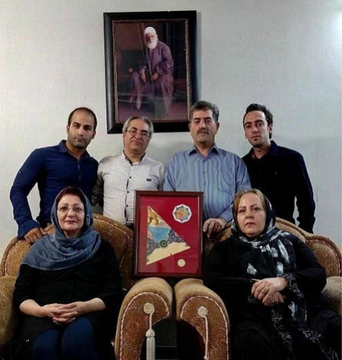 A group of Iranian Baha'is received the fragment of artwork on behalf of the Baha'is of Iran.