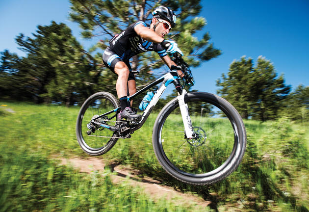 Professional mountain biker Sina Solouksaran catches air while going over a bump on a trail in White Ranch Open Space Park near Golden, Colorado, Friday June 24, 2016. Solouksaran, a refugee originally from Iran after being banned from biking due to not being a practicing Muslim, now lives and trains in Golden after living in Turkey for a couple years. Photo by Matt Nager