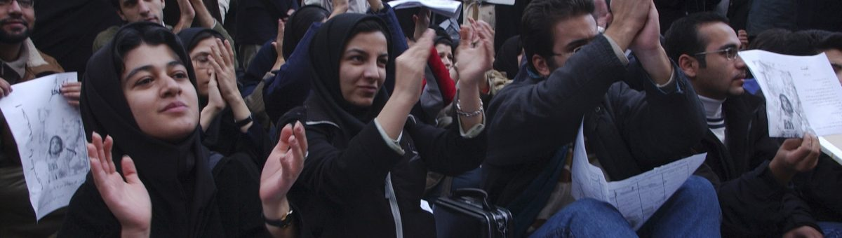 In this Dec. 7, 2003 photo, female Iranian university students, along with male students, attend a gathering to mark national annual Student Day, at Tehran University campus in Iran. Image via AP.