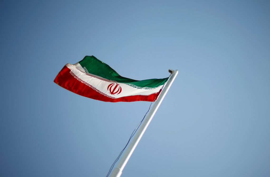An Iranian national flag flutters during the opening ceremony of the 16th International Oil, Gas & Petrochemical Exhibition (IOGPE) in Tehran, Iran, on April 15, 2011. Photo by STR/File Photo/Reuters