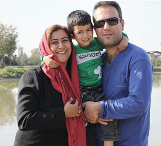 Azita Rafizadeh and her husband Peyman Kooshkebaghi, who both taught computer engineering at BIHE and are now in prison. While their 5-year old son is outside. (Niknaz Aftahi)