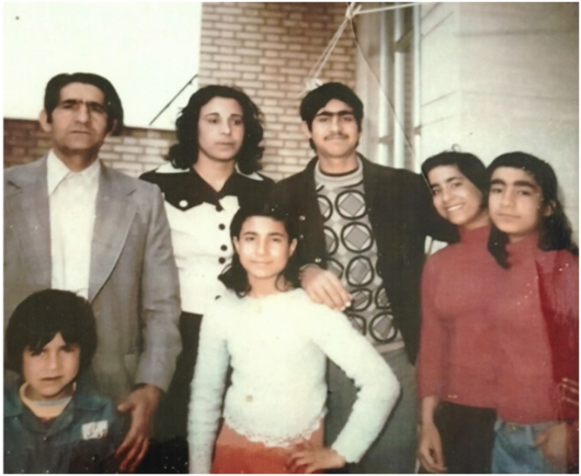 Photo of Ziaullah Haghighat, 47, with his wife and children. Afshin, 8, is standing in front of his father. This photo was taken forty days before the killing of Ziaullah.