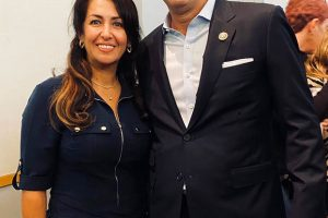 Soheila Abbassi, a member of a Baha'i delegation, poses with Rep. Harley Rouda at a Dec. 14, 2019, town hall meeting. Photo courtesy of Susan Fothergill