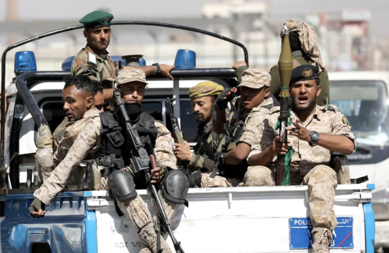 Houthi troops ride on the back of a police patrol truck after participating in a Houthi gathering in Sanaa, Yemen February 19, 2020. (photo credit: KHALED ABDULLAH/ REUTERS)